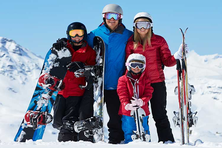 Snow Apparel Sale - Family smiling in the snow